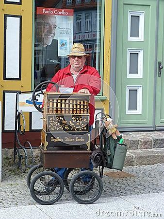 Free Busker Playing Barrel Organ Stock Photo - 19343710