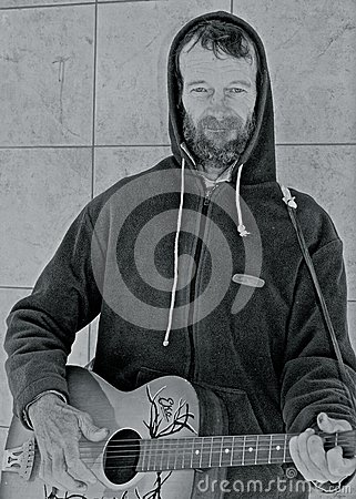 Free Busker Playing His Guitar. Stock Photos - 45856433