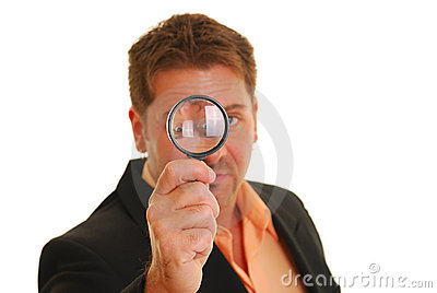Bussiness man holding a magnifying glass