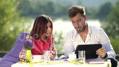 Bussinesspeople working with tablet outdoors stock footage