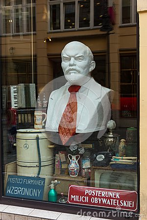 Bust of Lenin and antiques curio in shop window. Poznan. Poland Editorial Stock Photo