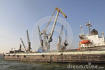 Crane Loading a Cargo Ship - World Business - Economy