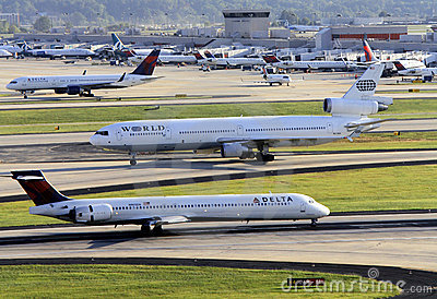 Busy airport scene with multiple planes Editorial Photo