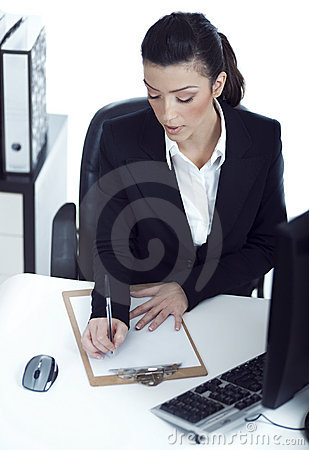 Busy business lady making her notes