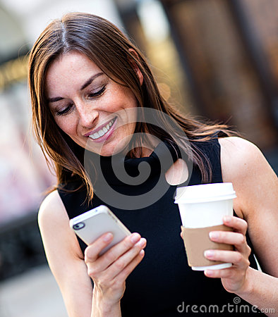 Busy business woman texting