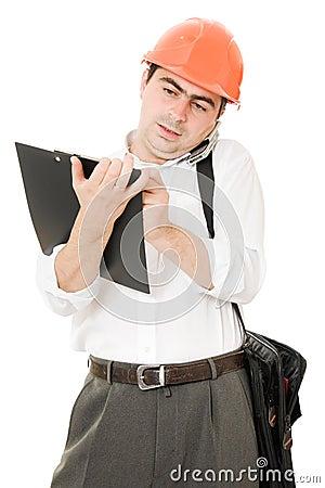 Busy businessman in his helmet