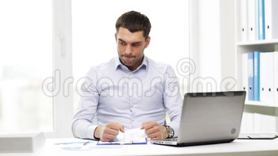 Busy Businessman With Laptop And Papers In Office Stock ...