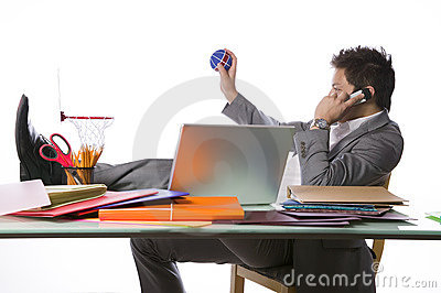 Busy businessman playing office basketball
