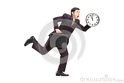 Busy businessman running with wall clock and briefcase