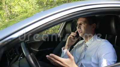 Busy bussinessman arguing on phone in car stock video