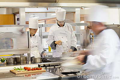 Busy chefs at work in the kitchen