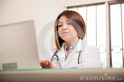 Busy Doctor Working On Laptop Stock Photo - Image: 49732617