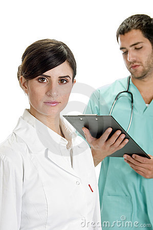 Busy doctor writing on pad  with nurse