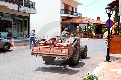 Busy Greek farmer drives his tractor Editorial Stock Image