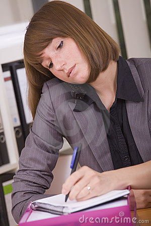 Busy secretary with phone