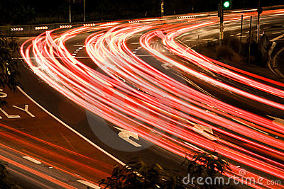 Busy traffic light streaks at night