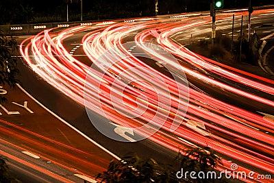 Busy traffic light streaks at night