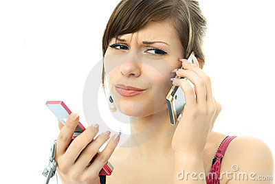 Busy unhappy beautiful woman with two cellphones
