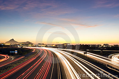 Busy urban highway at dusk