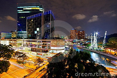 Busy and urban night life along Singapore River Editorial Stock Photo