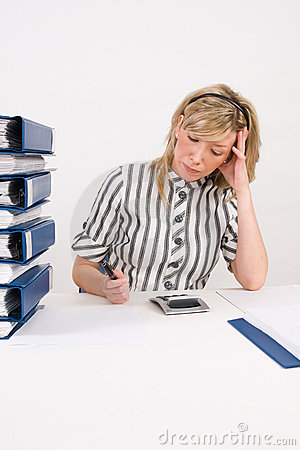 Busy woman working at desk