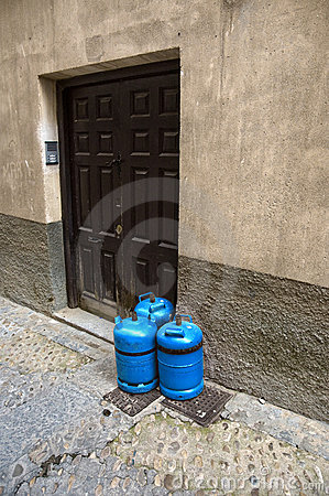 Butane gas cylinders at a house door