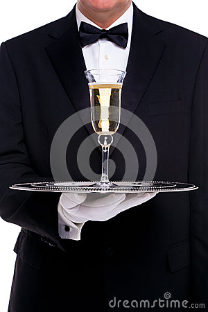 Free Butler Serving A Glass Of Champagne Royalty Free Stock Photo - 28305835
