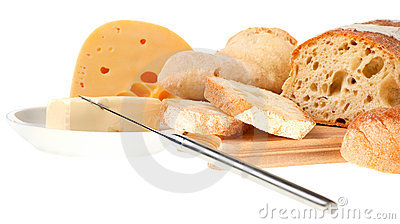Butter, cheese, bread and a knife