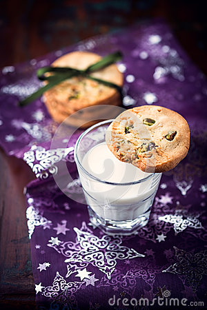 Butter cookie with pistachios on a glass of milk