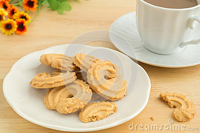Butter cookies and coffee cup