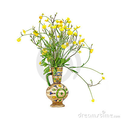 Buttercup flowers in colorful vase