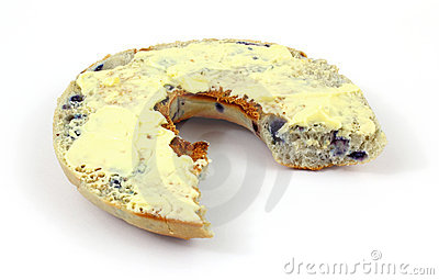 Buttered blueberry bagel that has been bitten