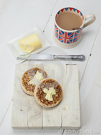 Buttered English crumpets with cup of tea