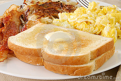 Buttered toast with bacon and eggs