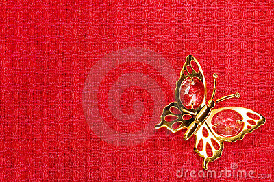 Butterfly On Red Textile Background