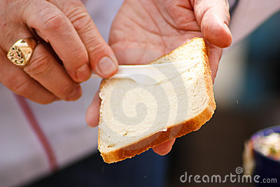 Buttering a slice of bread