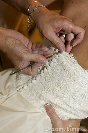 Buttoning into Wedding Dress