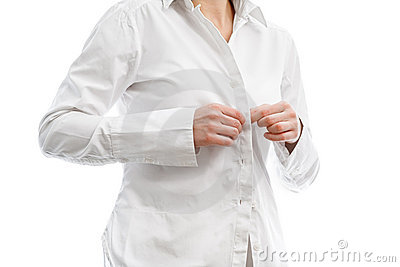 Buttoning a white shirt