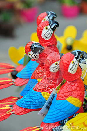 Buy me! - decorative parrot standing out in a row