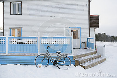 Bycicle outside snow road in Inari, Lapland, Finland