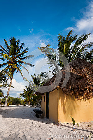 Cabanas huts on white sand beach in Mexico Tulum