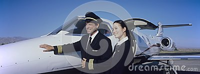 Cabin Crew Members By An Aircraft