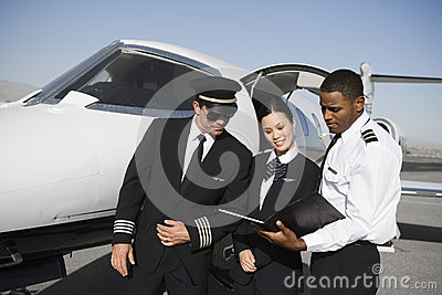 Cabin Crew Members Discussing Reports Together