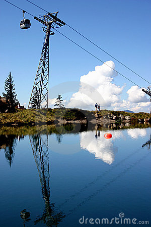 Cable car reflected in mountaintop lake