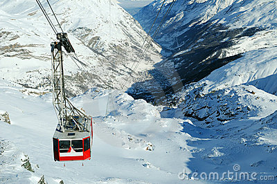 Cable car on snowy mountain