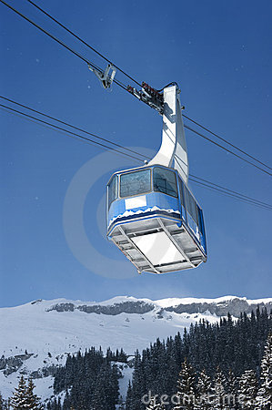 Cable car with specs of snow