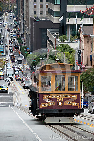 Cable car tram in San Francisco climbing up the street Editorial Image