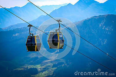 Cableway lift transportation in the alps mountains