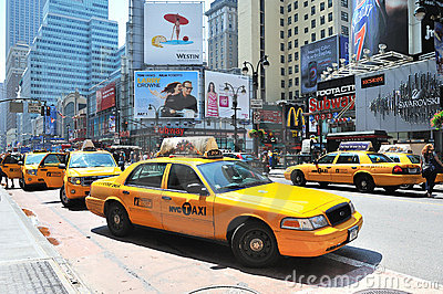 Cabs driving through manhattan midtown Editorial Photography