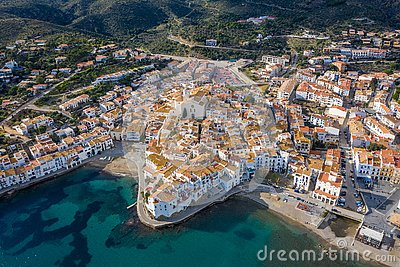 CAdaques Spain. Dali city. aerial top view from above. picturesque linen houses, tiled roofs and a church on the Stock Photo